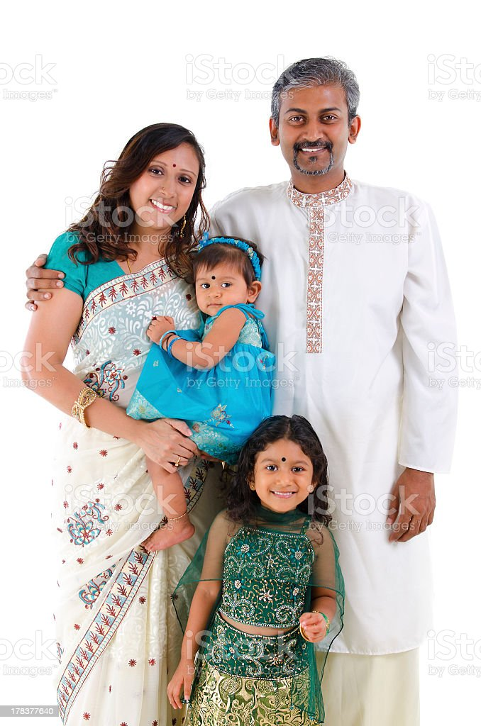 Smiling family of four in traditional Indian clothing stock photo