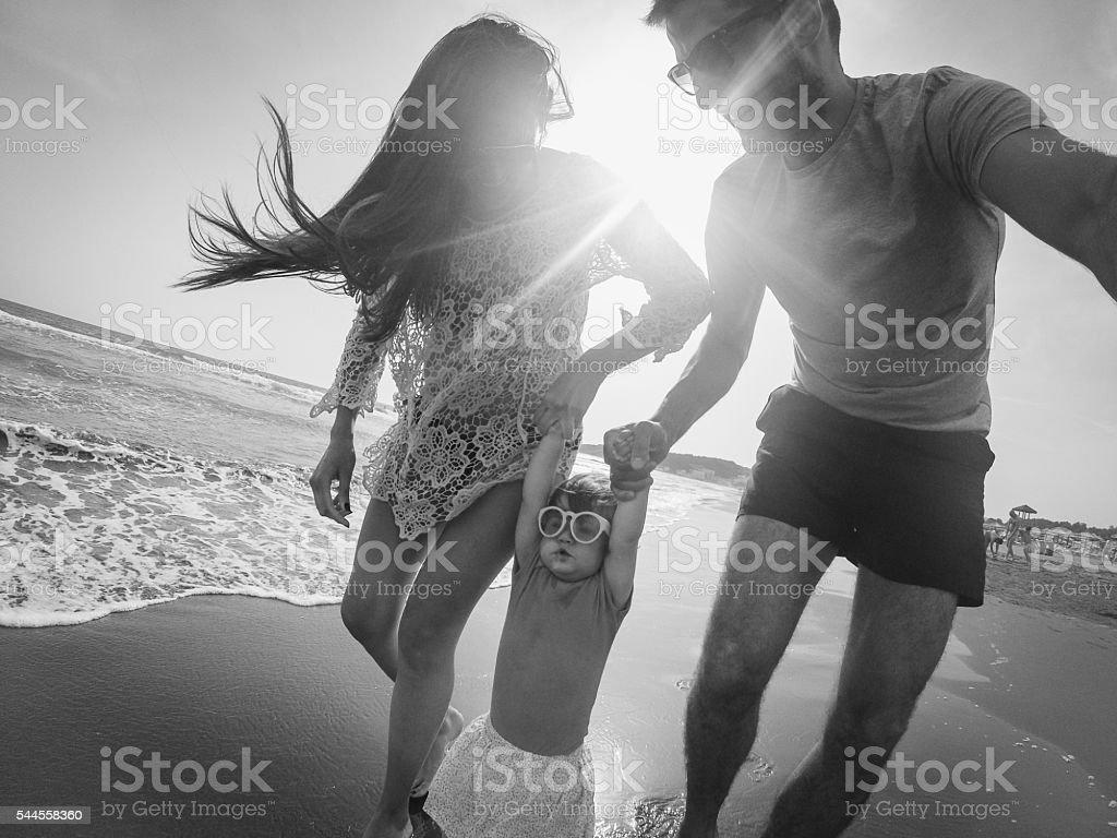Smiling family on beach stock photo