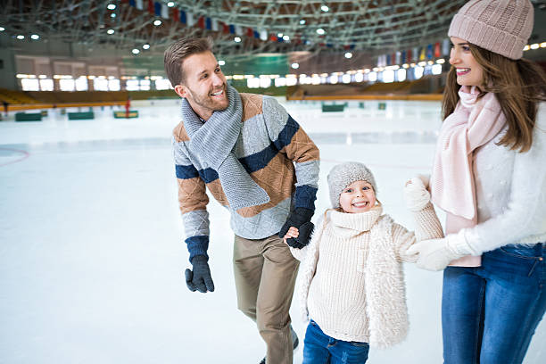 Smiling family Happy family at skating rink ice skating stock pictures, royalty-free photos & images