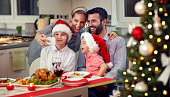 Young smiling family taking selfie for Christmas