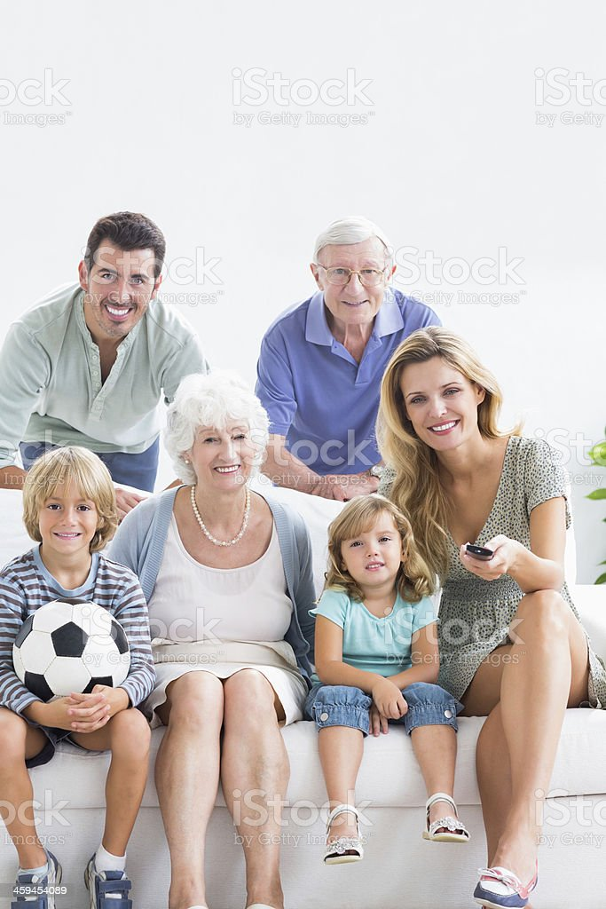 Smiling family watching the tv royalty-free stock photo