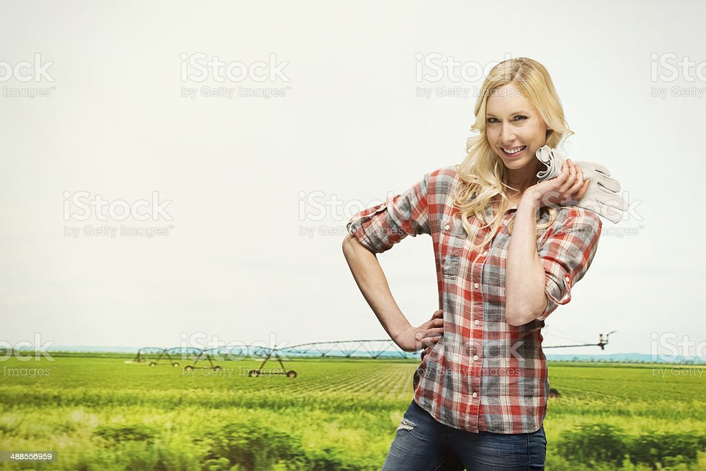 Smiling farmer in front of rural scene royalty-free stock photo