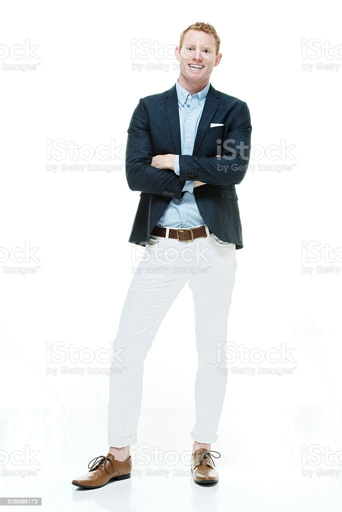 Smiling fashionable man standing with arms crossed stock photo