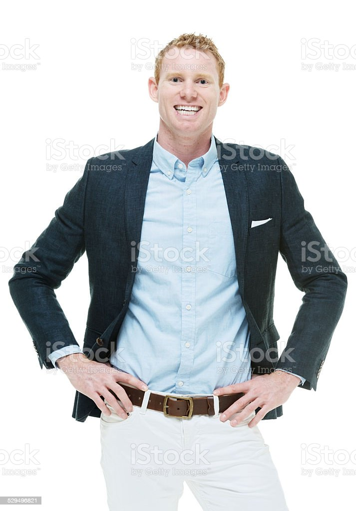 Smiling fashionable man standing with hands on hips stock photo