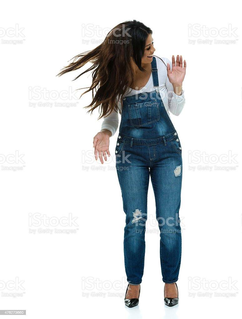 Smiling fashionable woman dancing stock photo