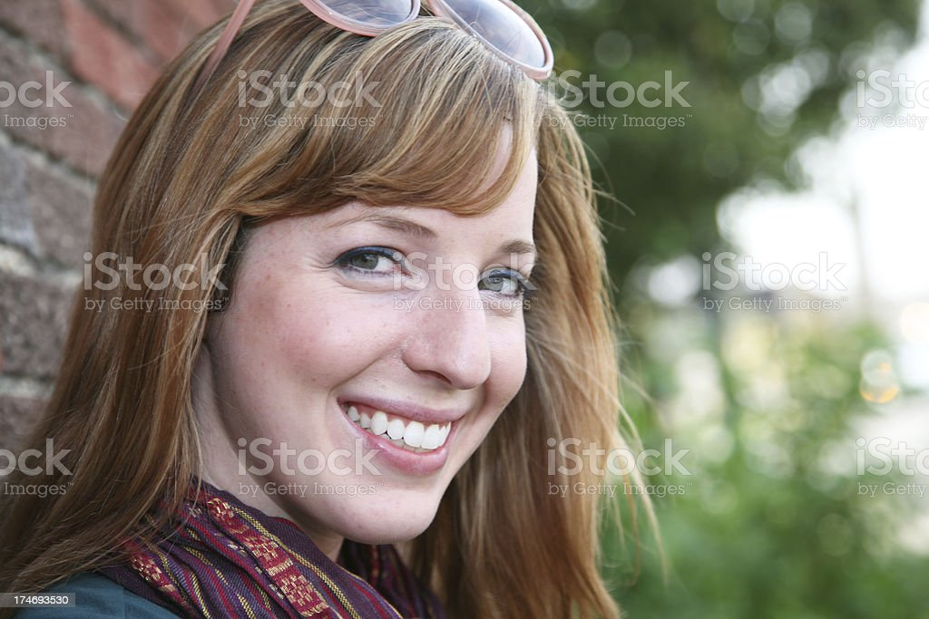 Smiling Fashionable Woman On A Sunny Day stock photo