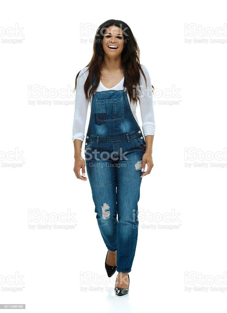Smiling fashionable woman walking stock photo
