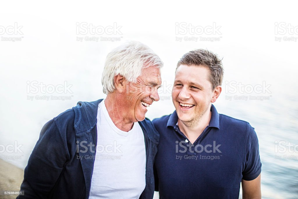 Smiling father and son stock photo