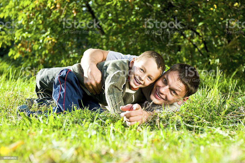Smiling father and son royalty-free stock photo