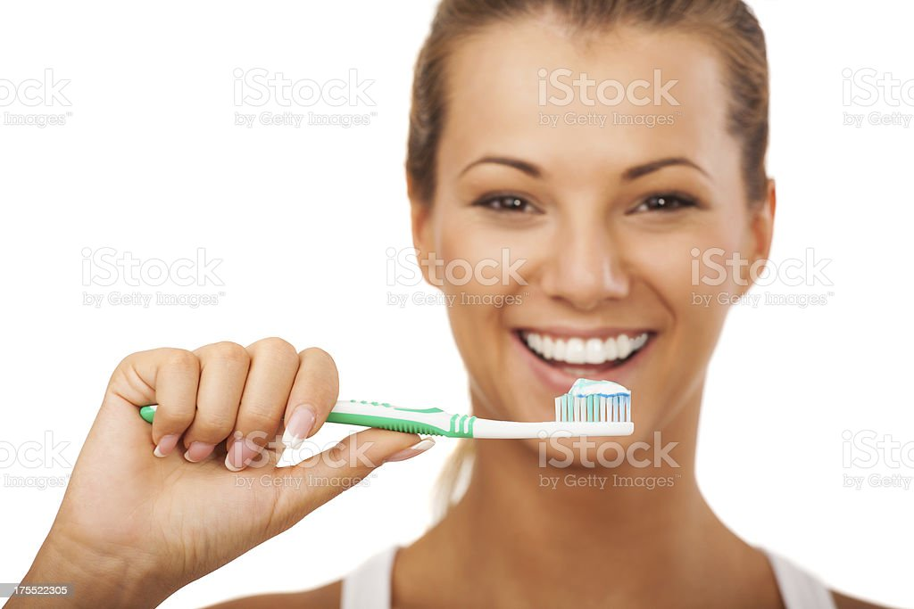 Smiling female about to brush her teeth royalty-free stock photo