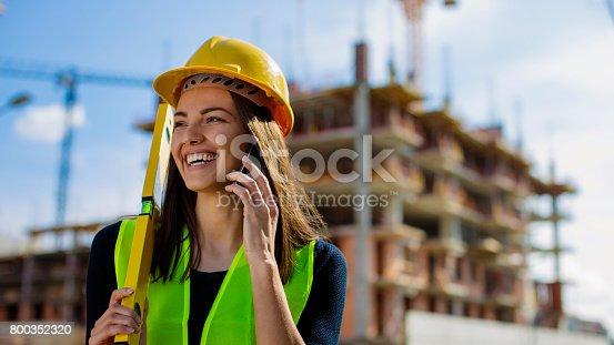 617878058 istock photo Smiling female at construcion site 800352320