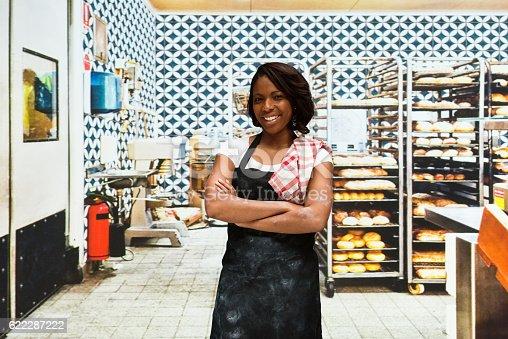 545282128 istock photo Smiling female baker standing in  bakery 622287222