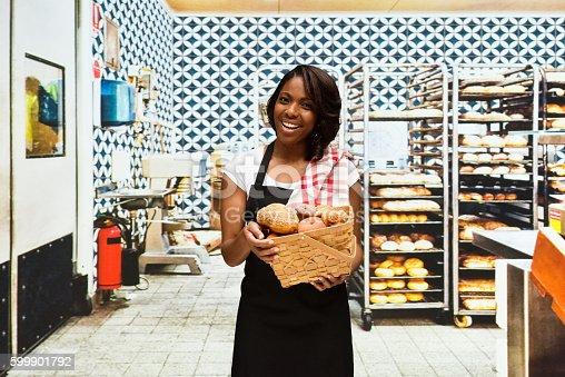 545282128 istock photo Smiling female baker working in bakery 599901792