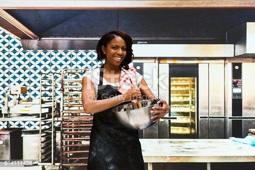 545282128 istock photo Smiling female baker working in bakery 614111438