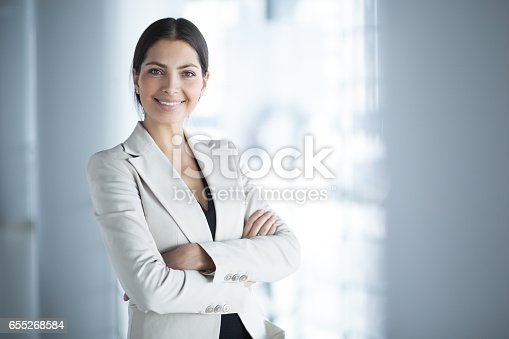 istock Smiling Female Business Leader With Arms Crossed 655268584