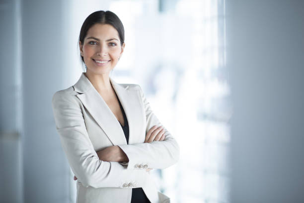 Smiling Female Business Leader With Arms Crossed stock photo