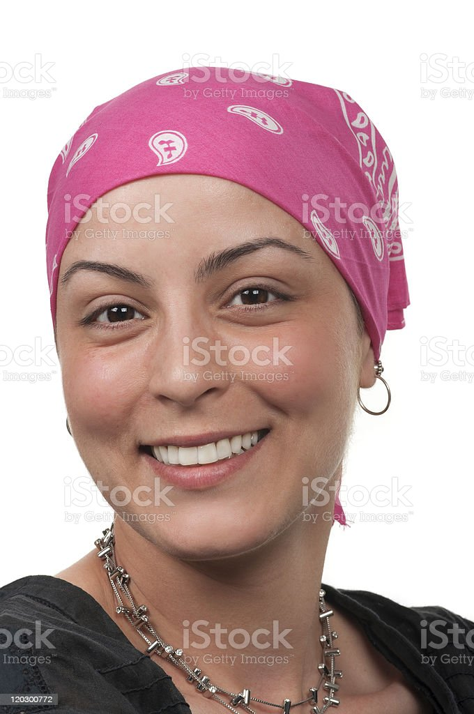 A smiling female cancer survivor wearing a pink bandanna royalty-free stock photo