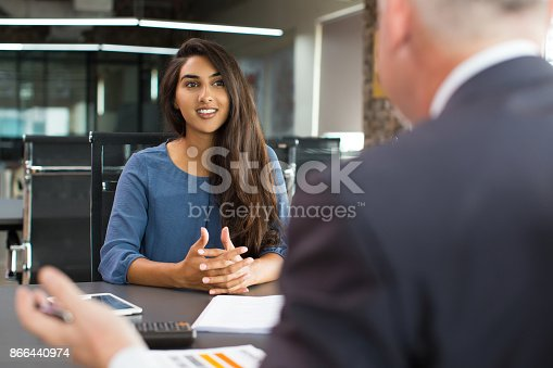 istock Smiling female client talking to male manager 866440974
