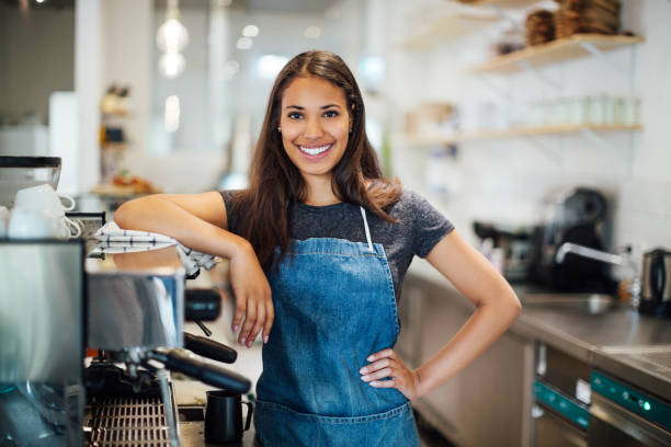 Smiling female coffee shop owner stock photo