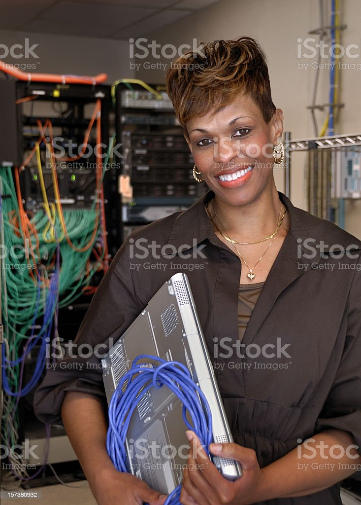 Smiling Female Computer IT Hardware Specialist royalty-free stock photo