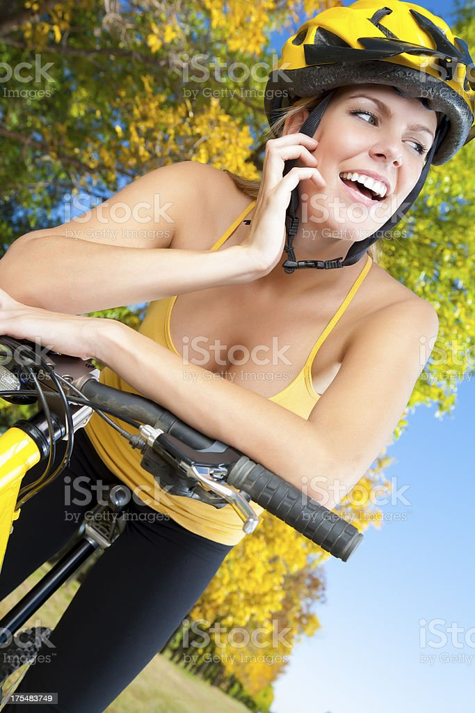 Smiling female cycling royalty-free stock photo