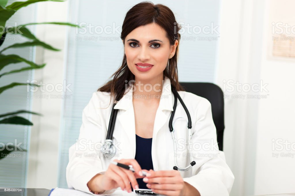 Smiling female doctor at work stock photo