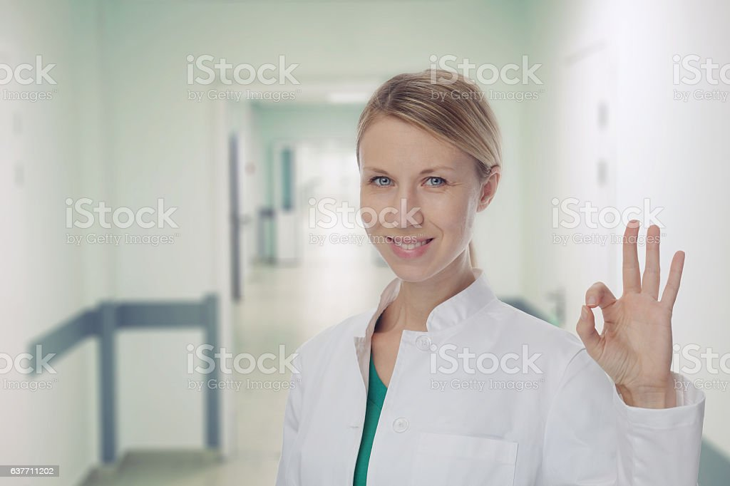 Smiling Female doctor  in hospital background. stock photo