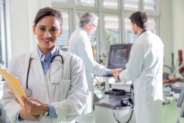 Smiling female doctor in hospital stock photo