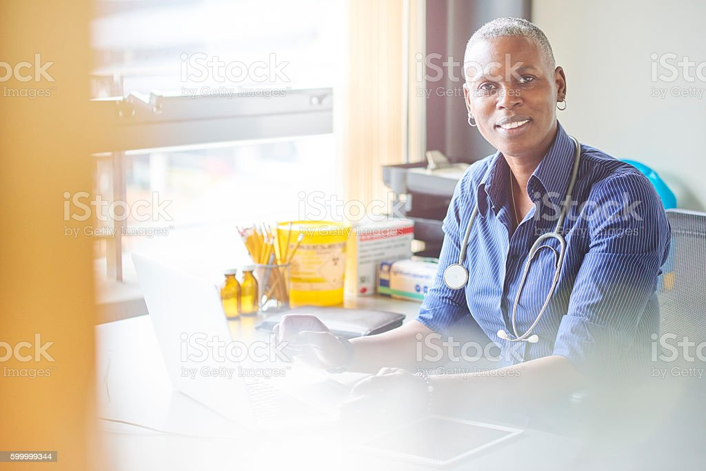 smiling female doctor stock photo