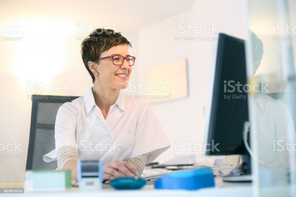 Smiling female doctor stock photo