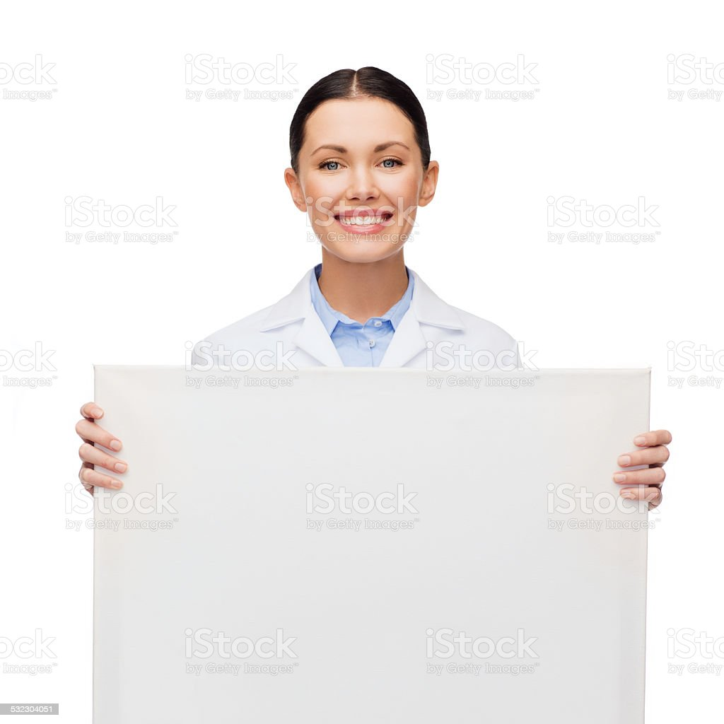 smiling female doctor with white blank board stock photo