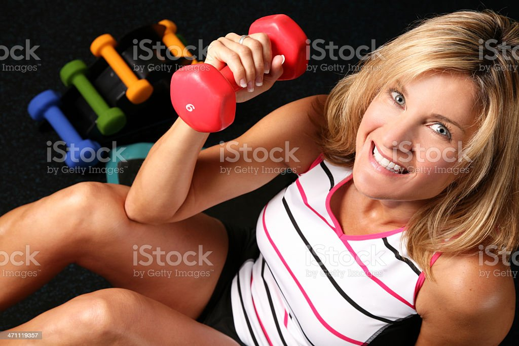 Smiling Female does Fitness Workout Exercise and Weight Training royalty-free stock photo