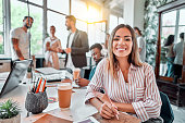 istock Smiling female employee sit in coworking space and working on the project 1283955441