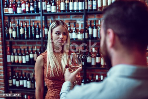 Smiling Female Enjoying Fine Wine With Significant Other