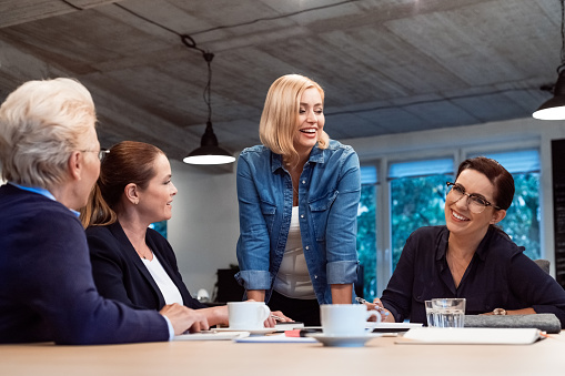 Smiling Female Entrepreneurs In Meeting At Office Stock Photo - Download Image Now