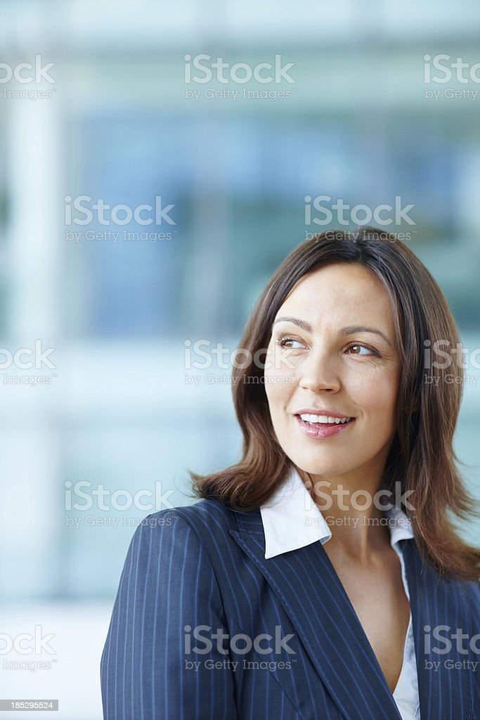Smiling female executive at office stock photo
