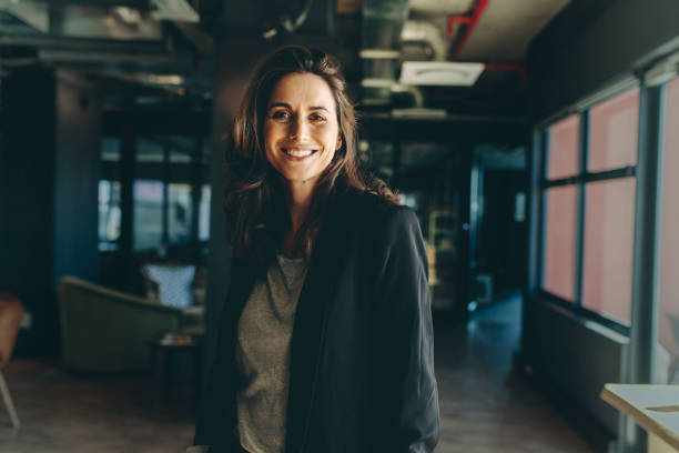 Smiling female executive in her office stock photo