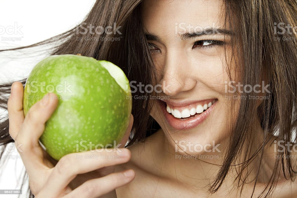 Smiling female face apple royalty-free stock photo