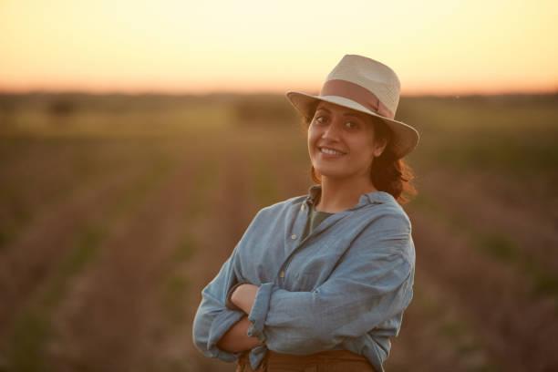 Smiling Female Farmer in Field stock photo