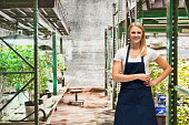istock Smiling female florist standing in marijuana plant 599693084