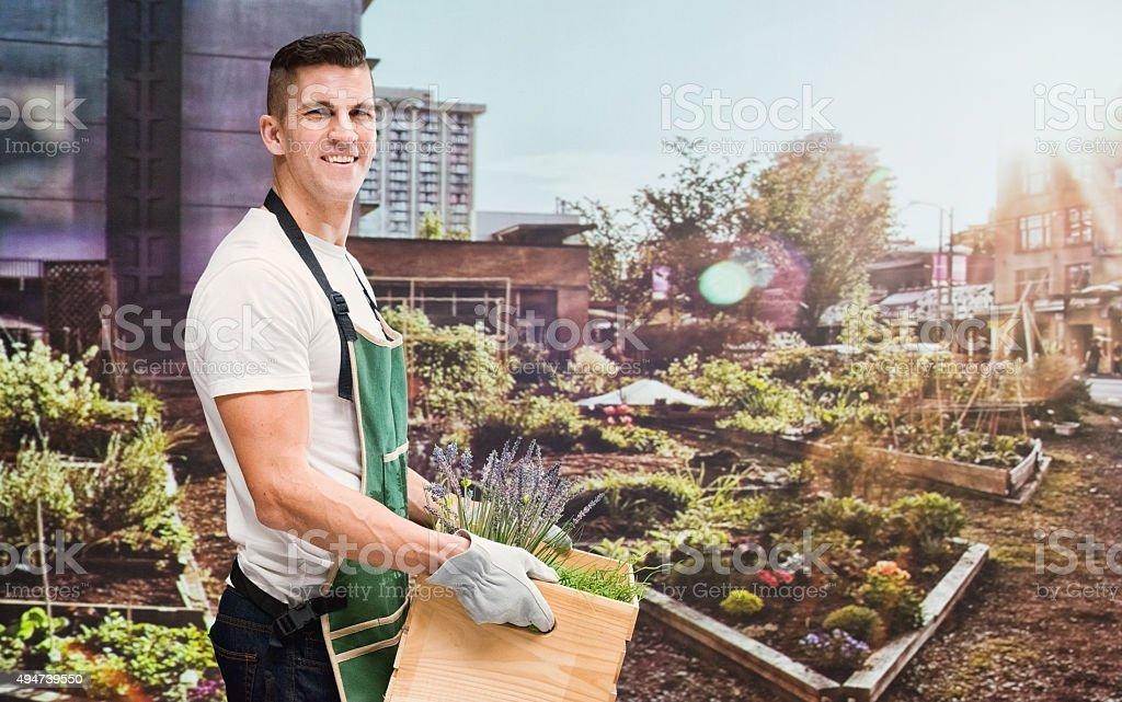 Smiling female gardener in the...
