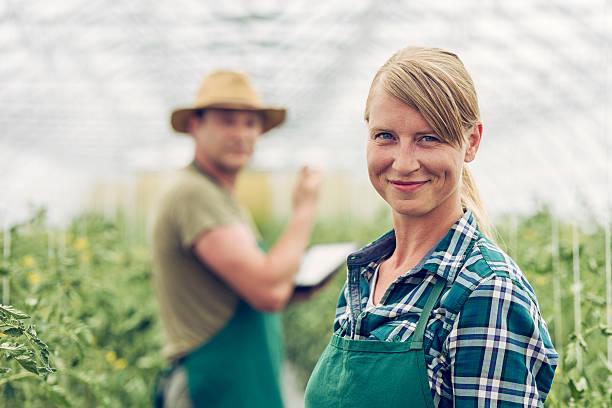Smiling female gardener stock photo