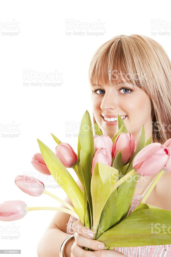 Smiling female holding a bunch of tulips royalty-free stock photo