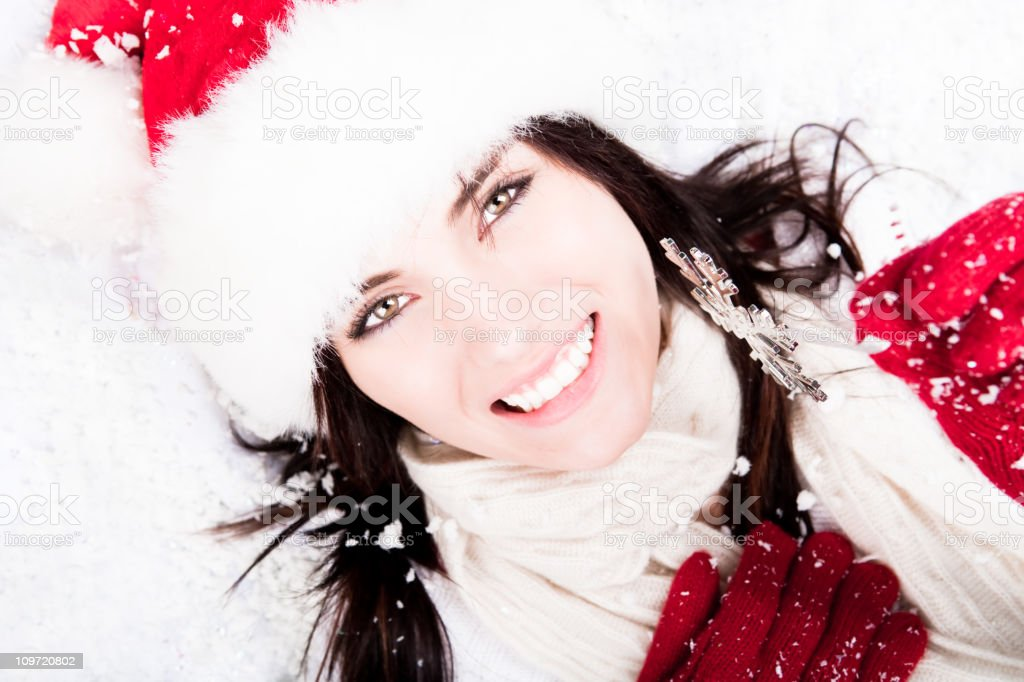 Smiling female holding a snowflake ornaments royalty-free stock photo