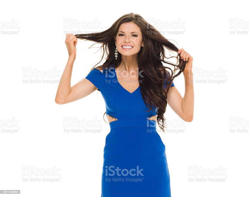 Smiling female holding hair photo libre de droits