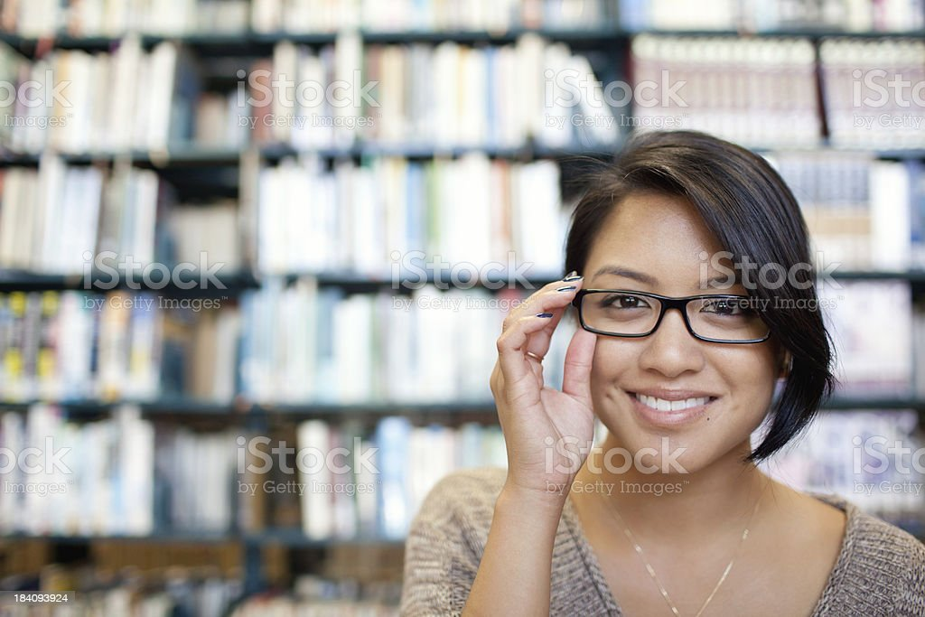 Smiling female in glasses at the library Female at the library Adult Stock Photo