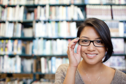 Smiling Female In Glasses At The Library Stock Photo - Download Image Now