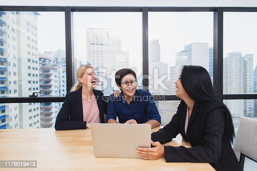 955988522istockphoto Smiling female lawyer or financial adviser show contract and insurance form agreement to multiracial couple customers at office 1179019413