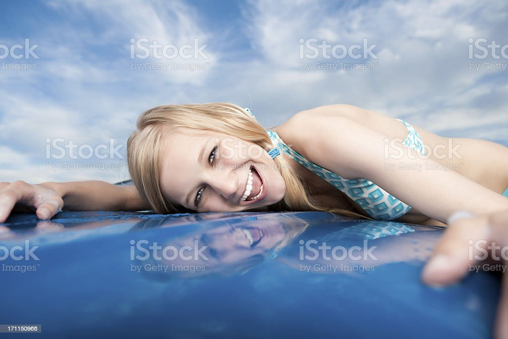Smiling Female Leaning on Car Hood royalty-free stock photo