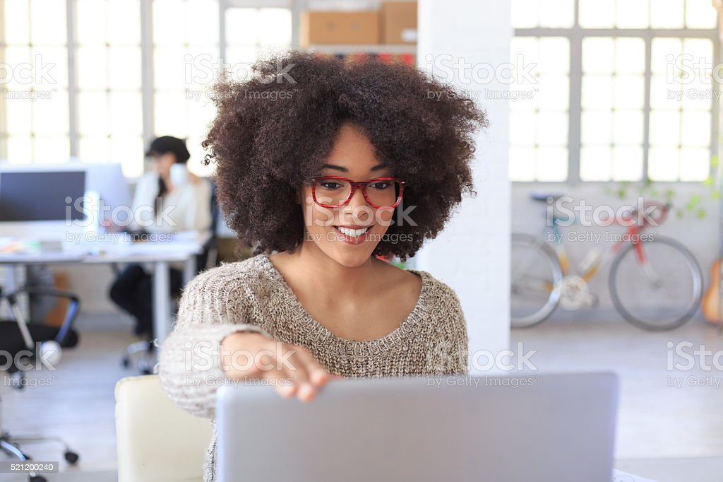 Smiling female manager finishing her works at the office stock photo